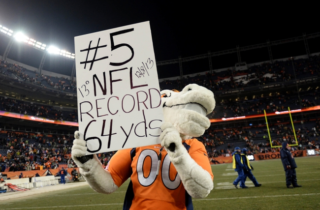 Dec 8, 2013; Denver, CO, USA; Denver Broncos mascot Miles holds a sign for Denver Broncos kicker Matt Prater (5) following the win over the Tennessee Titans at Sports Authority Field at Mile High. The Broncos defeated the Titans 51-28. Mandatory Credit: Ron Chenoy-USA TODAY Sports