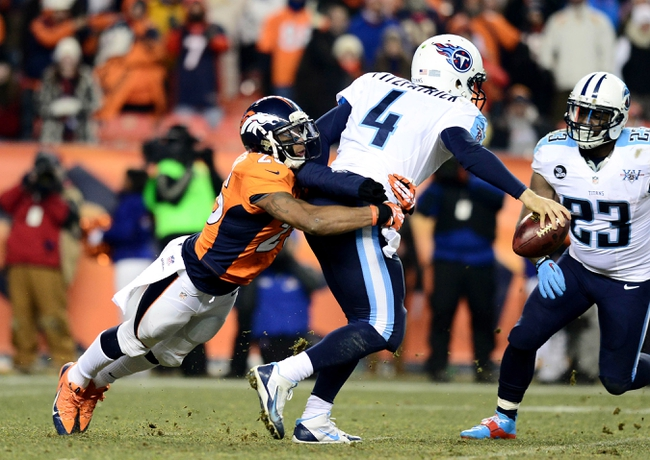Dec 8, 2013; Denver, CO, USA; Denver Broncos cornerback Chris Harris (25) tackles Tennessee Titans quarterback Ryan Fitzpatrick (4) in the fourth quarter at Sports Authority Field at Mile High. The Broncos defeated the Titans 51-28. Mandatory Credit: Ron Chenoy-USA TODAY Sports