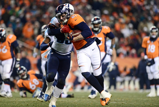 Dec 8, 2013; Denver, CO, USA; Tennessee Titans defensive tackle Jurrell Casey (99) tackles Denver Broncos tight end Joel Dreessen (81) after a reception in the fourth quarter at Sports Authority Field at Mile High. The Broncos defeated the Titans 51-28. Mandatory Credit: Ron Chenoy-USA TODAY Sports