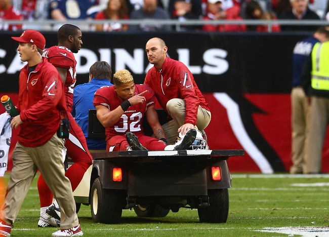 Dec 8, 2013; Phoenix, AZ, USA; Arizona Cardinals player Tyrann Mathieu (32) reacts as he is taken off the field after suffering an injury in the third quarter against the St. Louis Rams at University of Phoenix Stadium. The Cardinals defeated the Rams 30-10. Mandatory Credit: Mark J. Rebilas-USA TODAY Sports