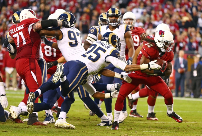 Dec 8, 2013; Phoenix, AZ, USA; Arizona Cardinals running back Andre Ellington (38) runs for a touchdown in the fourth quarter against the St. Louis Rams at University of Phoenix Stadium. The Cardinals defeated the Rams 30-10. Mandatory Credit: Mark J. Rebilas-USA TODAY Sports