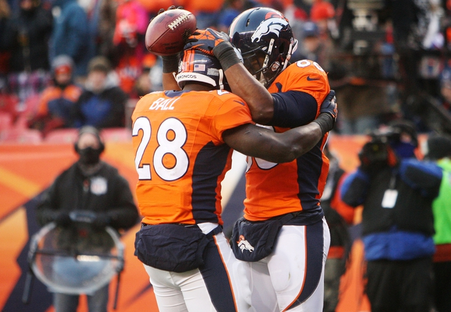 Dec 8, 2013; Denver, CO, USA; Denver Broncos wide receiver Demaryius Thomas (88) celebrates with running back Montee Ball (28) after scoring a touchdown during the second half against the Tennessee Titans at Sports Authority Field at Mile High. The Broncos won 51-28.  Mandatory Credit: Chris Humphreys-USA TODAY Sports
