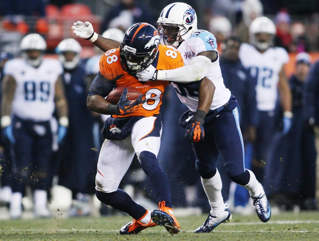 Dec 8, 2013; Denver, CO, USA; Denver Broncos wide receiver Demaryius Thomas (88) is tackled by Tennessee Titans cornerback Jason McCourty (30) during the second half at Mile High. The Broncos won 51-28.  Mandatory Credit: Chris Humphreys-USA TODAY Sports
