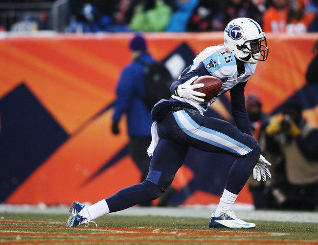 Dec 8, 2013; Denver, CO, USA; Tennessee Titans wide receiver Justin Hunter (15) celebrates after scoring a touchdown during the second half against the Denver Broncos at Sports Authority Field at Mile High. The Broncos won 51-28.  Mandatory Credit: Chris Humphreys-USA TODAY Sports
