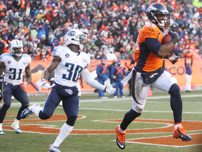 Dec 8, 2013; Denver, CO, USA; Denver Broncos wide receiver Demaryius Thomas (88) catches a touchdown pass during the second half against the Tennessee Titans at Sports Authority Field at Mile High. The Broncos won 51-28.  Mandatory Credit: Chris Humphreys-USA TODAY Sports