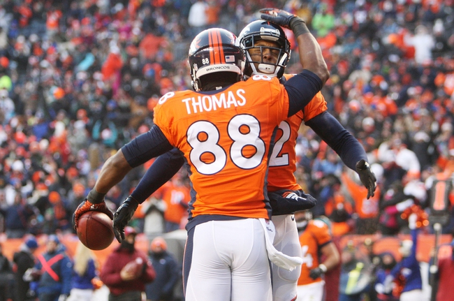 Dec 8, 2013; Denver, CO, USA; Denver Broncos wide receiver Demaryius Thomas (88) celebrates with wide receiver Andre Caldwell (back) after catching a touchdown pass during the second half against the Tennessee Titans at Sports Authority Field at Mile High. The Broncos won 51-28.  Mandatory Credit: Chris Humphreys-USA TODAY Sports