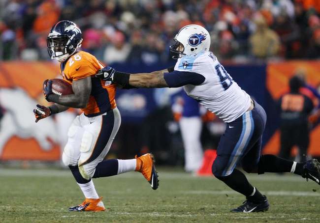 Dec 8, 2013; Denver, CO, USA; Denver Broncos running back Montee Ball (28) breaks a tackle during the second half against the Tennessee Titans at Sports Authority Field at Mile High. The Broncos won 51-28.  Mandatory Credit: Chris Humphreys-USA TODAY Sports