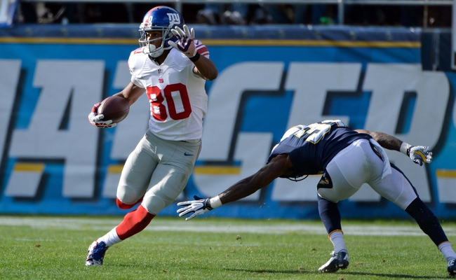 Dec 8, 2013; San Diego, CA, USA; New York Giants wide receiver Victor Cruz (80) runs past San Diego Chargers cornerback Richard Marshall (31) during first half action at Qualcomm Stadium. Mandatory Credit: Robert Hanashiro-USA TODAY Sports