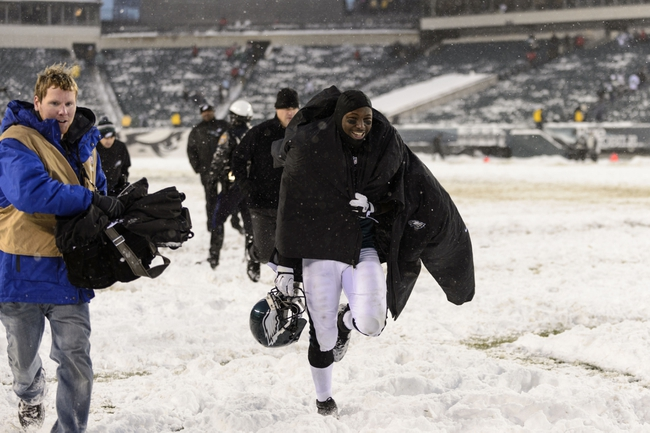 Dec 8, 2013; Philadelphia, PA, USA; Philadelphia Eagles running back LeSean McCoy (25) runs off the field after defeating the Detroit Lions at Lincoln Financial Field. The Eagles defeated the Lions 34-20. Mandatory Credit: Howard Smith-USA TODAY Sports