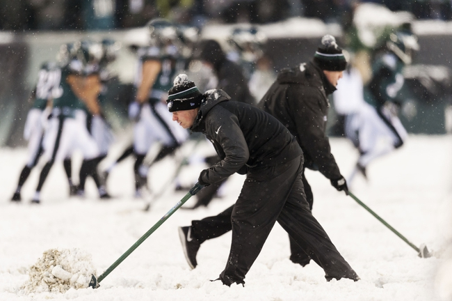 Dec 8, 2013; Philadelphia, PA, USA; Philadelphia Eagles grounds crew members clear snow off the field during the fourth quarter against the Detroit Lions at Lincoln Financial Field. The Eagles defeated the Lions 34-20. Mandatory Credit: Howard Smith-USA TODAY Sports