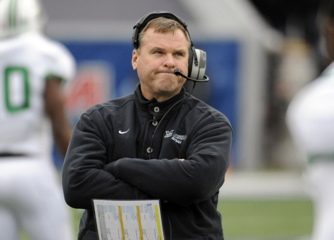 Dec 7, 2013; Houston, TX, USA; (Editors note: Caption correction) Marshall Thundering Herd defensive coordinator Chuck Heater reacts against the Rice Owls during the first half at Rice Stadium. Mandatory Credit: Brendan Maloney-USA TODAY Sports