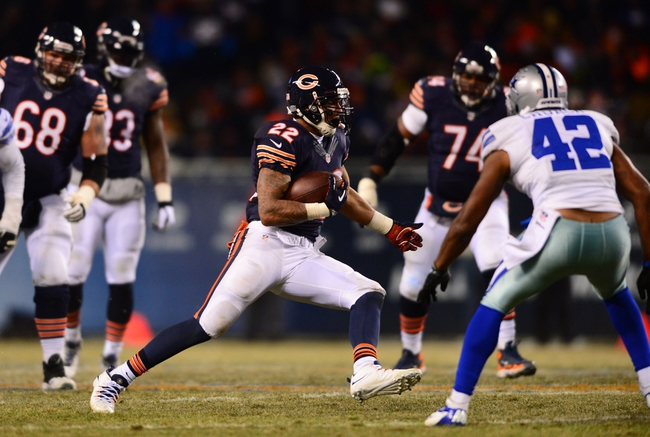 Dec 9, 2013; Chicago, IL, USA; Chicago Bears running back Matt Forte (22) runs the ball during the third quarter against the Dallas Cowboys at Soldier Field. Mandatory Credit: Andrew Weber-USA TODAY Sports