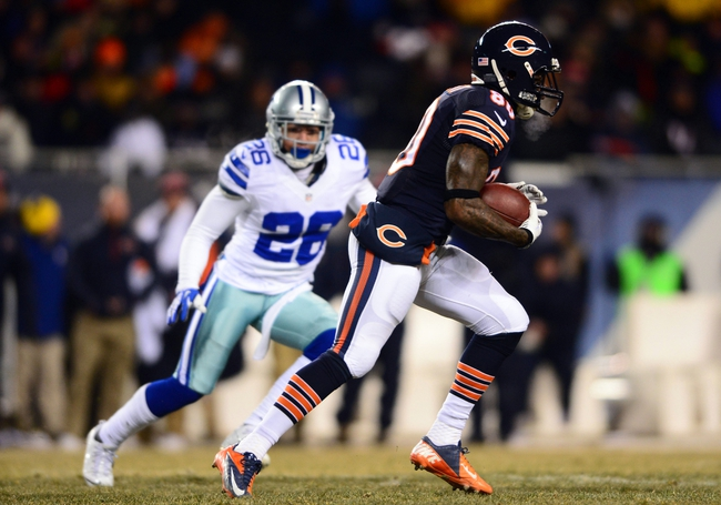 Dec 9, 2013; Chicago, IL, USA; Chicago Bears wide receiver Earl Bennett (80) makes a catch and looks to get run during the third quarter against the Dallas Cowboys at Soldier Field. Mandatory Credit: Andrew Weber-USA TODAY Sports