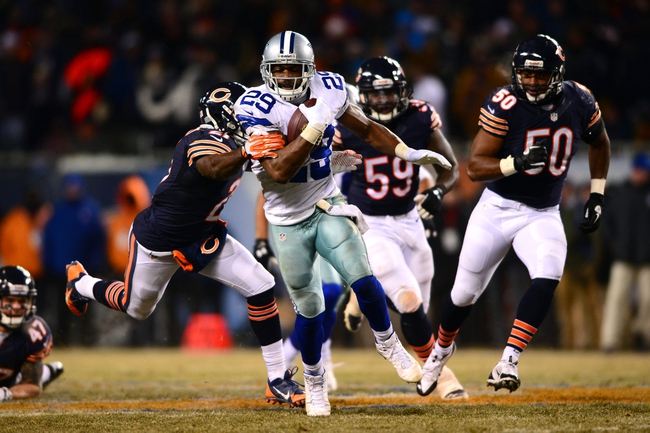 Dec 9, 2013; Chicago, IL, USA; Dallas Cowboys running back DeMarco Murray (29) runs the ball during the fourth quarter against the Chicago Bears at Soldier Field. Mandatory Credit: Andrew Weber-USA TODAY Sports