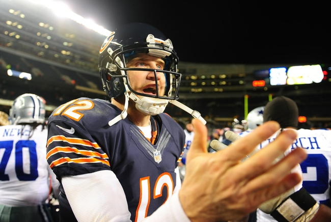 Dec 9, 2013; Chicago, IL, USA; Chicago Bears quarterback Josh McCown (12) walks off the field after defeating Dallas Cowboys 45-28 at Soldier Field. Mandatory Credit: Andrew Weber-USA TODAY Sports