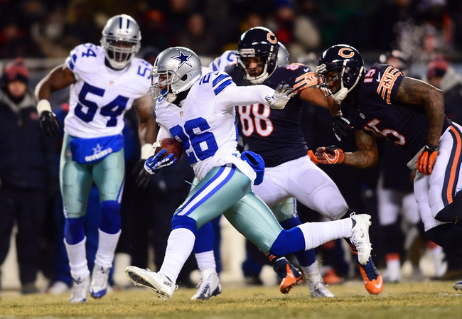 Dec 9, 2013; Chicago, IL, USA; Dallas Cowboys defensive back Sterling Moore (26) intercepts a pass and looks for running room during the fourth quarter against the Chicago Bears at Soldier Field. Mandatory Credit: Andrew Weber-USA TODAY Sports