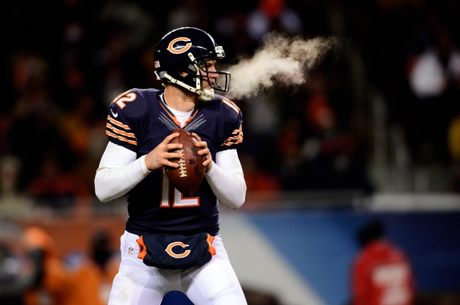 Dec 9, 2013; Chicago, IL, USA; Chicago Bears quarterback Josh McCown (12) looks to pass during the third quarter against the Dallas Cowboys at Soldier Field. Mandatory Credit: Andrew Weber-USA TODAY Sports