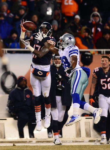 Dec 9, 2013; Chicago, IL, USA; Chicago Bears wide receiver Alshon Jeffery (17) is unable to make a catch while being defended by Dallas Cowboys cornerback Brandon Carr (39) during the fourth quarter at Soldier Field. Mandatory Credit: Andrew Weber-USA TODAY Sports