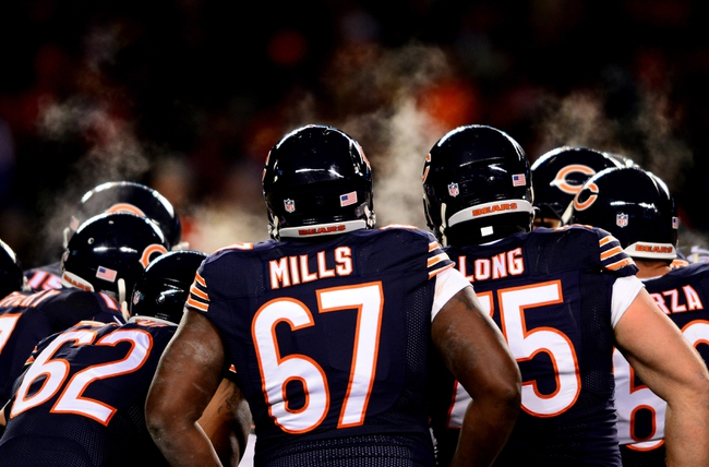 Dec 9, 2013; Chicago, IL, USA; Steam comes from the helmets of Chicago Bears offensive lineman during the fourth quarter against the Dallas Cowboys at Soldier Field. Mandatory Credit: Andrew Weber-USA TODAY Sports