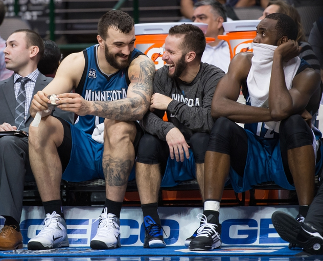 Nov 30, 2013; Dallas, TX, USA; Minnesota Timberwolves center Nikola Pekovic (14) and point guard J.J. Barea (11) share a laugh during the game against the Dallas Mavericks at the American Airlines Center. The Timberwolves defeated the Mavericks 112-106. Mandatory Credit: Jerome Miron-USA TODAY Sports