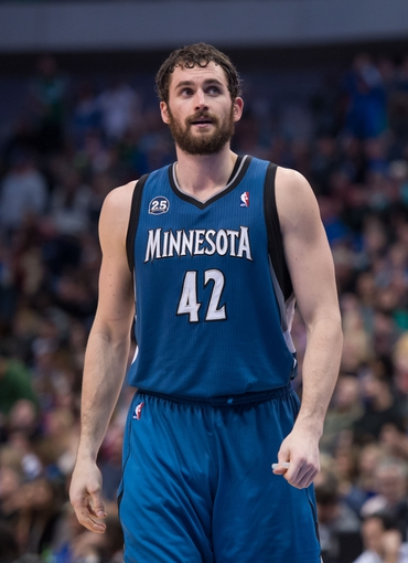 Nov 30, 2013; Dallas, TX, USA; Minnesota Timberwolves power forward Kevin Love (42) waits for play to begin against the Dallas Mavericks during the game at the American Airlines Center. The Timberwolves defeated the Mavericks 112-106. Mandatory Credit: Jerome Miron-USA TODAY Sports