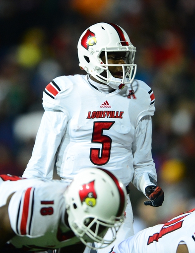 Dec 5, 2013; Cincinnati, OH, USA; Louisville Cardinals quarterback Teddy Bridgewater (5) against the