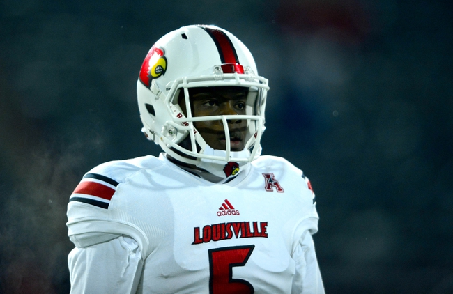 Dec 5, 2013; Cincinnati, OH, USA; Louisville Cardinals quarterback Teddy Bridgewater (5) against the Cincinnati Bearcats at Nippert Stadium. Mandatory Credit: Andrew Weber-USA TODAY Sports
