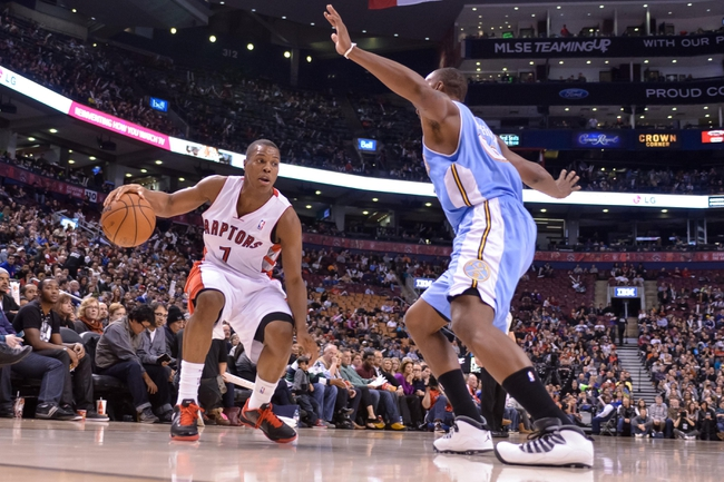 Dec 1, 2013; Toronto, Ontario, CAN; Toronto Raptors point guard Kyle Lowry (7) drives the ball past Denver Nuggets power forward Darrell Arthur (00)  during the third quarter of a game at the Air Canada Centre. Denver won the game 112-98. Mandatory Credit: Mark Konezny-USA TODAY Sports
