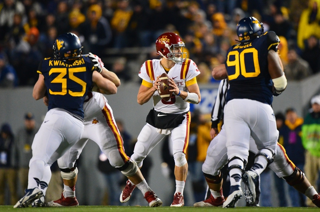 Nov 30, 2013; Morgantown, WV, USA; Iowa State Cyclones quarterback Grant Rohach (3) looks down field from the pocket during the second half of the game against West Virginia Mountaineers at Milan Puskar Stadium. The Iowa State Cyclones defeated West Virginia Mountaineers 52-44 in the third overtime. Mandatory Credit: Tommy Gilligan-USA TODAY Sports