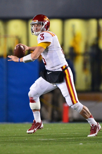 Nov 30, 2013; Morgantown, WV, USA; Iowa State Cyclones quarterback Grant Rohach (3) throws the ball on the run during the second half of the game against West Virginia Mountaineers at Milan Puskar Stadium. The Iowa State Cyclones defeated West Virginia Mountaineers 52-44 in the third overtime. Mandatory Credit: Tommy Gilligan-USA TODAY Sports