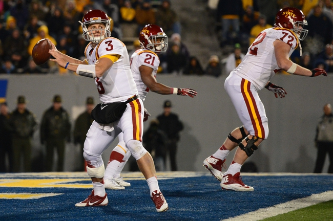 Nov 30, 2013; Morgantown, WV, USA; Iowa State Cyclones quarterback Grant Rohach (3) throws the ball from the end zone during the third quarter of the game West Virginia Mountaineers at Milan Puskar Stadium. The Iowa State Cyclones defeated West Virginia Mountaineers 52-44 in the third overtime. Mandatory Credit: Tommy Gilligan-USA TODAY Sports