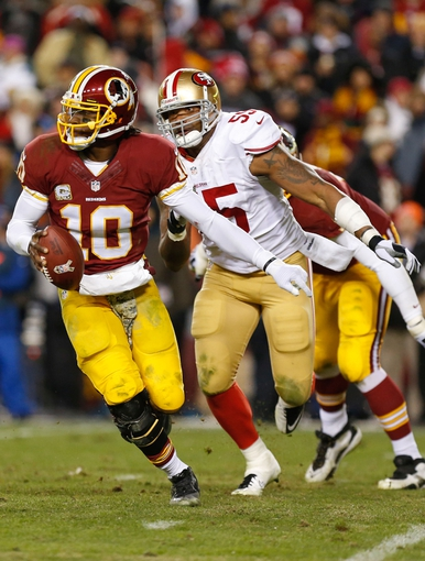 Nov 25, 2013; Landover, MD, USA; San Francisco 49ers outside linebacker Ahmad Brooks (55) chases Washington Redskins quarterback Robert Griffin III (10) at FedEx Field. Mandatory Credit: Geoff Burke-USA TODAY Sports