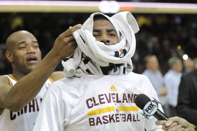 Dec 10, 2013; Cleveland, OH, USA; Cleveland Cavaliers point guard Jarrett Jack (left) interrupts  a post game interview with point guard Kyrie Irving after a 109-94 win over the New York Knicks at Quicken Loans Arena. Mandatory Credit: David Richard-USA TODAY Sports