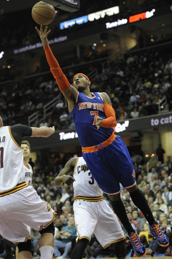 Dec 10, 2013; Cleveland, OH, USA; New York Knicks small forward Carmelo Anthony (7) shoots in the fourth quarter against the Cleveland Cavaliers at Quicken Loans Arena. Mandatory Credit: David Richard-USA TODAY Sports