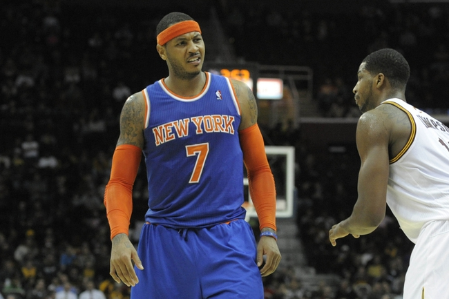 Dec 10, 2013; Cleveland, OH, USA; New York Knicks small forward Carmelo Anthony (7) reacts beside Cleveland Cavaliers power forward Tristan Thompson in the fourth quarter at Quicken Loans Arena. Mandatory Credit: David Richard-USA TODAY Sports