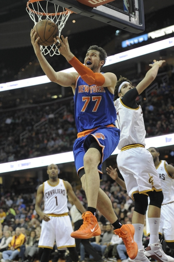 Dec 10, 2013; Cleveland, OH, USA; New York Knicks power forward Andrea Bargnani (77) drives to the basket against the Cleveland Cavaliers in the fourth quarter at Quicken Loans Arena. Mandatory Credit: David Richard-USA TODAY Sports