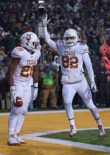 Dec 7, 2013; Waco, TX, USA; Texas Longhorns running back Malcolm Brown (28) and tight end Geoff Swaim (82)  celebrate Browns touchdown catch against the Baylor Bears during the game at Floyd Casey Stadium. The Baylor Bears defeated the Texas Longhorns 30-10 to win the Big 12 championship. Mandatory Credit: Jerome Miron-USA TODAY Sports
