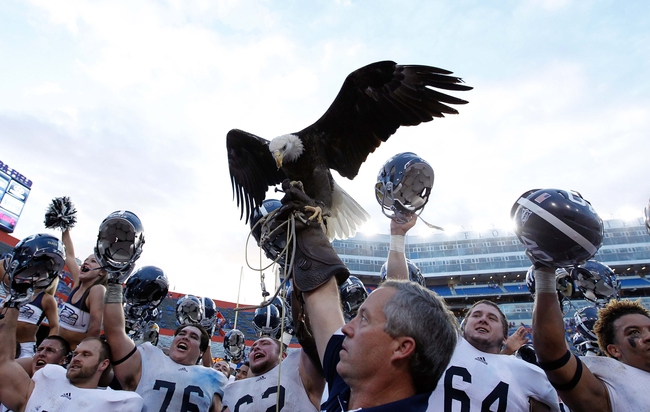 Nov 23, 2013; Gainesville, FL, USA; Georgia Southern Eagles reacts and celebrate with their mascot, the Eagle, after they beat the Florida Gators at Ben Hill Griffin Stadium. Georgia Southern Eagles defeated the Florida Gators 26-20. Mandatory Credit: Kim Klement-USA TODAY Sports