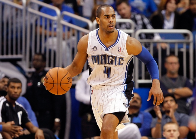Nov 24, 2013; Orlando, FL, USA; Orlando Magic shooting guard Arron Afflalo (4) dribbles the ball against the Phoenix Suns during the second half at Amway Center. Phoenix Suns defeated the Orlando Magic 104-96. Mandatory Credit: Kim Klement-USA TODAY Sports
