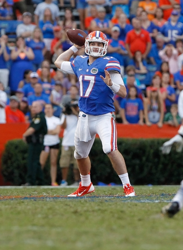 Nov 23, 2013; Gainesville, FL, USA; Florida Gators quarterback Skyler Mornhinweg (17) throws the ball against the Georgia Southern Eagles during the second half at Ben Hill Griffin Stadium. Georgia Southern Eagles defeated the Florida Gators 26-20. Mandatory Credit: Kim Klement-USA TODAY Sports