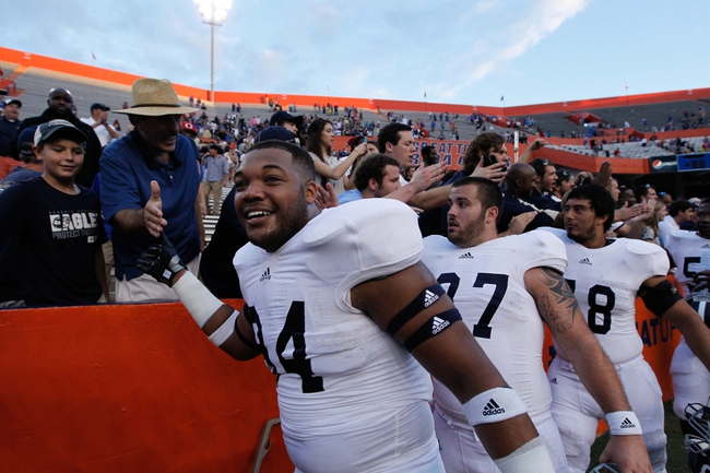 Nov 23, 2013; Gainesville, FL, USA; Georgia Southern Eagles defensive end Tre Griffin (94) celebrates and reacts with players after they beat the Florida Gators at Ben Hill Griffin Stadium. Georgia Southern Eagles defeated the Florida Gators 26-20. Mandatory Credit: Kim Klement-USA TODAY Sports