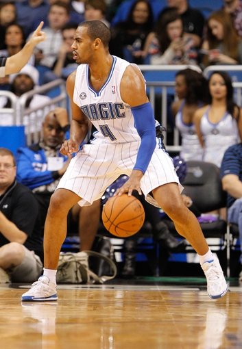 Nov 24, 2013; Orlando, FL, USA; Orlando Magic shooting guard Arron Afflalo (4) dribbles the ball against the Phoenix Suns during the second quarter at Amway Center. Mandatory Credit: Kim Klement-USA TODAY Sports