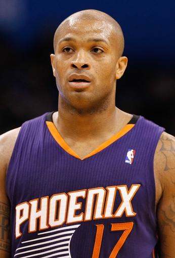 Nov 24, 2013; Orlando, FL, USA; Phoenix Suns small forward P.J. Tucker (17) against the Orlando Magic during the second half at Amway Center. Phoenix Suns 104-96. Mandatory Credit: Kim Klement-USA TODAY Sports