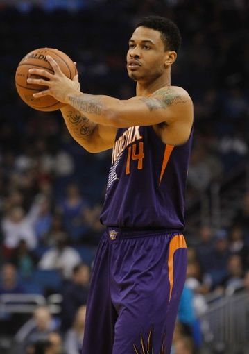 Nov 24, 2013; Orlando, FL, USA; Phoenix Suns shooting guard Gerald Green (14) against the Orlando Magic during the first quarter at Amway Center. Mandatory Credit: Kim Klement-USA TODAY Sports