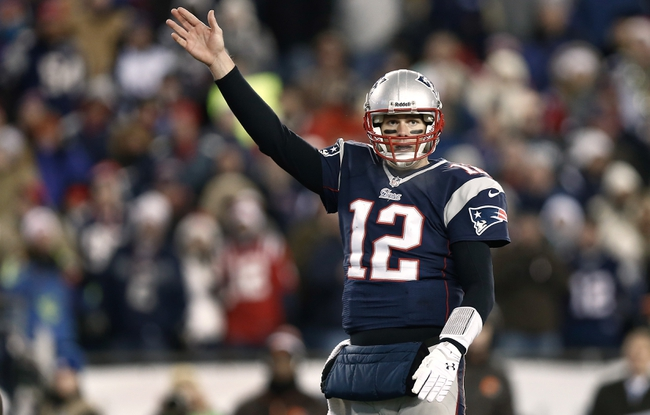 Dec 8, 2013; Foxborough, MA, USA; New England Patriots quarterback Tom Brady (12) signals a first down during the fourth quarter of New England's 27-26 win over the Cleveland Browns at Gillette Stadium. Mandatory Credit: Winslow Townson-USA TODAY Sports