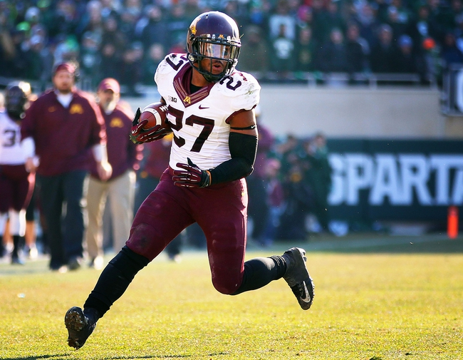 Nov 30, 2013; East Lansing, MI, USA; Minnesota Golden Gophers running back David Cobb (27) runs the ball against the Michigan State Spartans during the 1st half a game at Spartan Stadium. Mandatory Credit: Mike Carter-USA TODAY Sports