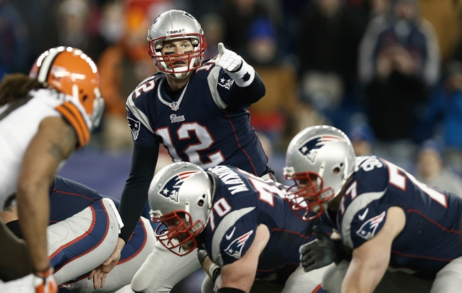Dec 8, 2013; Foxborough, MA, USA; New England Patriots quarterback Tom Brady (12) before the snap during the fourth quarter of New England's 27-26 win over the Cleveland Browns at Gillette Stadium. Mandatory Credit: Winslow Townson-USA TODAY Sports
