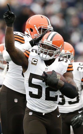 Dec 8, 2013; Foxborough, MA, USA; Cleveland Browns inside linebacker D'Qwell Jackson (52) celebrates intercepting a pass against the New England Patriots during the first half at Gillette Stadium. Mandatory Credit: Winslow Townson-USA TODAY Sports