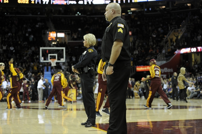 Dec 10, 2013; Cleveland, OH, USA; Cleveland police officers and arena security personnel stand on the court during a timeout in a game between the Cleveland Cavaliers and the New York Knicks at Quicken Loans Arena. Mandatory Credit: David Richard-USA TODAY Sports