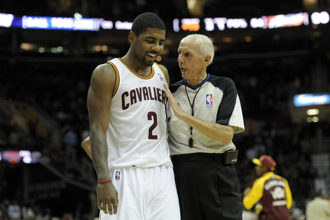 Dec 10, 2013; Cleveland, OH, USA; NBA referee Dick Bavetta talks to Cleveland Cavaliers point guard Kyrie Irving (2) during a game with the New York Knicks at Quicken Loans Arena. Mandatory Credit: David Richard-USA TODAY Sports